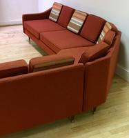 back of rustic orange reupholstered sofa from the 1960s