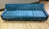 front view of mid century sofa in a reupholstered teal fabric